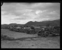 Row of automobiles damaged by the flood that followed the failure of the Saint Francis Dam, Santa Clara River Valley (Calif.), 1928