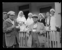 Five Red Cross workers serving coffee to relief workers after the flood following the failure of the Saint Francis Dam, Santa Clara River Valley (Calif.), 1928