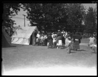 Displaced families in line for medical assistance after the failure of the Saint Francis Dam and resulting flood, Santa Clara River Valley (Calif.), 1928