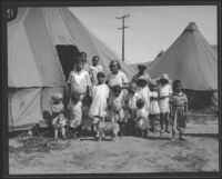 Women and children stand outside a tent after the flood resulting from the failure of the Saint Francis Dam, Santa Clara River Valley (Calif.), 1928