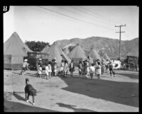 Children gathered in front of tents after the failure of the Saint Francis Dam and resulting flood, Santa Clara River Valley (Calif.), 1928