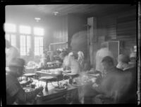 Flood relief workers (?) eating at a u-shaped bar following the failure of the Saint Francis Dam, Santa Clara River Valley (Calif.), 1928