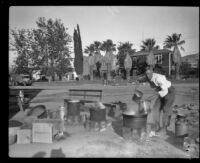 Man at work in a field kitchen for survivors and/or aid workers after the Saint Francis Dam failure and resulting flood, Santa Clara River Valley, 1928