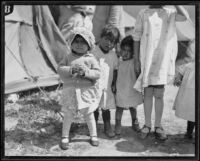 Child survivors at a relief camp after the failure of the Saint Francis Dam and resulting flood, Santa Clara River Valley (Calif.), 1928