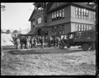 Flood relief workers outside a Victorian building after the flood resulting from the failure of the St. Francis Dam, Santa Clara River Valley, 1928