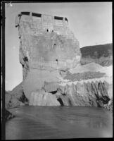 View of the remaining center portion of the St. Francis Dam after its disastrous collapse, San Francisquito Canyon (Calif.), 1928