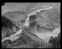 Downward view towards the remaining center portion of the St. Francis Dam after its disastrous collapse, San Francisquito Canyon (Calif.), 1928