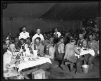 Survivors and/or relief workers eating a meal in a tent following the flood resulting from the failure of the Saint Francis Dam, Santa Clara River Valley (Calif.), 1928