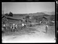 African American workers clearing flood debris following the flood resulting from the failure of the Saint Francis Dam, Santa Clara River Valley, 1928