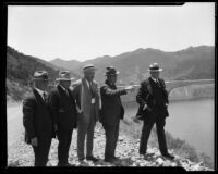 William Mulholland and 4 other men on the east bank of the St. Francis Reservoir, San Francisquito Canyon, circa 1926-1928