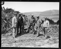 Six geologists and/or civil engineers standing in front of flood debris following the flood resulting from the failure of the Saint Francis Dam, San Francisquito Canyon (Calif.), 1928