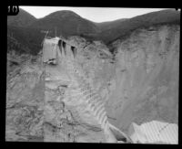 Side view of the remaining center portion of the St. Francis Dam visible after its disastrous collapse, San Francisquito Canyon (Calif.), 1928