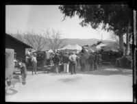 Men standing outside tents in the days following the failure of the Saint Francis Dam and resulting flood, Bardsdale (Calif.), 1928