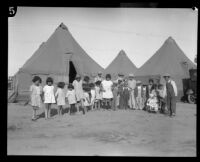 Group portrait of children outside tents after the flood resulting from the failure of the Saint Francis Dam, Santa Clara River Valley (Calif.), 1928