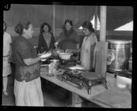 Women cooking tortillas and other food at a relief camp after the flood resulting from the Saint Francis Dam failure, Santa Clara River Valley (Calif.), 1928