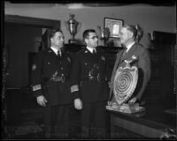 Theodore A. Winston presents trophy to James E. Davis and Roy Steckel, Los Angeles, ca. 1935