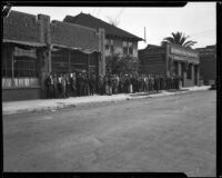Unemployed men line up to register for work on San Pedro St., Los Angeles, 1929-1939