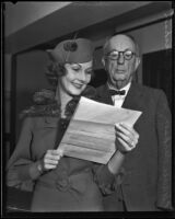 Floreine Dickson and father, Hugh L. Dickson, reading letter, Los Angeles, 1930-1939