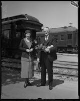 Mr. L. A. Downs, president of the Illinois Central Railroad, and his wife at a railroad station, 1926-1938