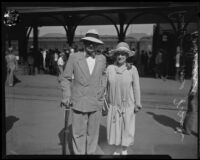 Dr. Frank Dyer and wife at train station, Los Angeles, 1920-1939