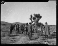 Men investigate an area of the Mojave Desert in search of the remains of murder victims of Gordon Stewart Northcott, Rivrside County, 1928-1929