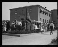 Booths in front of a building dispensing relief after the Long Beach earthquake, Southern California, 1933