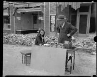 Man and woman conducting business (?) on the street after the Long Beach earthquake, Southern California, 1933