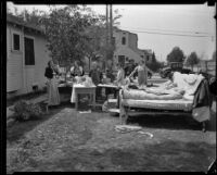 People camped out in their front yard after the Long Beach earthquake, Soutehrn California, 1933