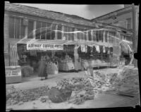 Grocery store with brick rubble on street in front after the Long Beach earthquake, Southern California, 1933