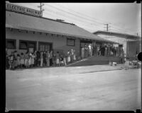People lined up to receive aid after the Long Beach earthquake, Southern California, 1933