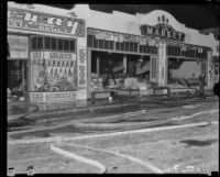 E. F. Smith's Market after a fire started by the Long Beach earthquake, Watts (Los Angeles), 1933