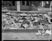 Rubble on a commercial street after the Long Beach earthquake, Southern California, 1933