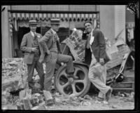 Three men next to automobile crushed by Long Beach Earthquake debris, southern California, 1933