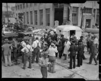 News crews and Chili Bowl truck outside a building damaged by the Long Beach earthquake, Southern California, 1933