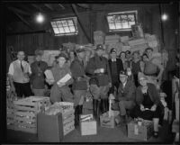 Relief workers in a warehouse full of provisions after the Long Beach earthquake, Southern California, 1933