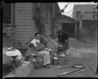 Weizel family living outside of their house after the earthquake, Long Beach, 1933