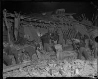 Workers going through the rubble of a ruined building after the Long Beach earthquake, Southern California, 1933
