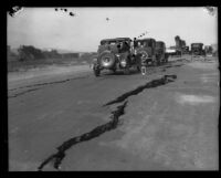 Automobiles on a road with wide cracks after the Long Beach earthquake, Southern California, 1933