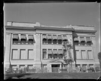 Institutional or commercial building with damaged parapet after the Long Beach earthquake, Southern California, 1933