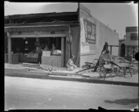 Reconstruction work on the G. V. Tucknott fruit and vegetable store building after the Long Beach earthquake, Southern California, 1933