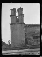 Santa Barbara Mission, exterior view of the bell tower following the earthquake, 1925