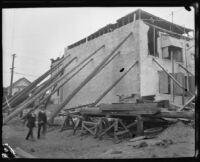 Building propped up with long poles after the earthquake, Santa Barbara, 1925