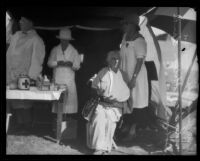 Three relief workers and a treated woman in a tent at a disaster relief station after the earthquake, Santa Barbara, 1925