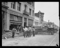 Workers clearing rubble from earthquake-damaged buildings on a commercial street, Santa Barbara, 1925