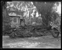 Flood (?) debris on a residential area road following the earthquake and failure of the Sheffield Dam, Santa Barbara, 1925