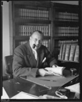 Judge Ellis Egan sits at desk, California, 1926-1939