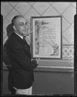 Harbor Dept. general manager Arthur Eldridge with framed document commemorating his appointment, Los Angeles, 1934