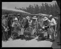 Farmers with produce at the Los Angeles Farmers' Market at 3rd & Fairfax during its opening, Los Angeles, 1934