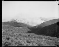 Smoke rolling over hills from the National Forest fire, California, 1932