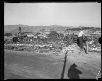M. D. Martin, proprietor of the National Forest Inn, observes damage following a fire, California, 1932